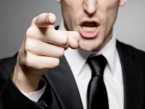 Boss points finger.